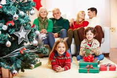Family with three generations at christmas eve Royalty Free Stock Photo