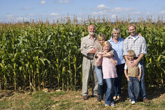 Family of three generations by corn field, smiling, portrait Stock Images