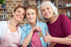 Family of three generations. Happy family of three generations smiling and looking at camera. Senior women showing thumb up Royalty Free Stock Image