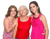 Family of three generations of hispanic women. Happy family of three generations of hispanic women isolated on white Stock Photo