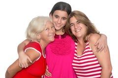 Family of three generations of hispanic women. Happy family of three generations of hispanic women isolated on white Stock Image