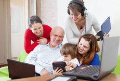 Family of three generations uses few various electronic device Stock Photo