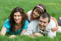 Family of three on the grass Stock Images