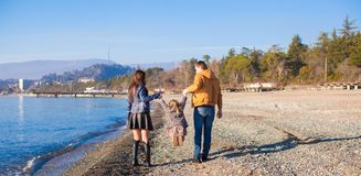 Family of three have fun near the Black Sea in Royalty Free Stock Photos