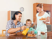 Family of three having breakfast at home Stock Images