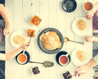 Family of three having breakfast Royalty Free Stock Photography