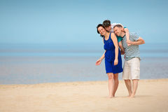 Family of three having fun on tropical beach Royalty Free Stock Photo