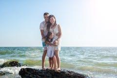 Family on tropical beach Stock Photos
