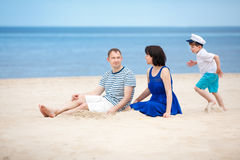 Family of three having fun on tropical beach Stock Photography