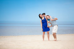 Family of three having fun on tropical beach Royalty Free Stock Photos