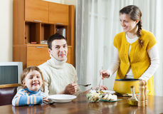 Family of three having lunch at home Stock Photography