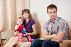 Family of three having quarrel Royalty Free Stock Photo