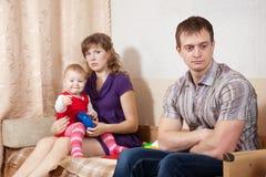 Family of three having quarrel. At home Royalty Free Stock Photo
