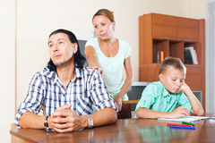 Family of three having quarrel. Family of three with teenage son having quarrel at home Royalty Free Stock Photography