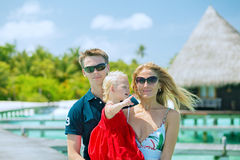 Family of three having vacation Stock Photos