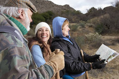 Family Of Three Hiking Together In Desert Royalty Free Stock Photo