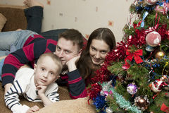 Family of three at home celebrating Christmas Royalty Free Stock Photography