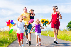 Family with three kids stock image