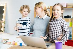 Family of three learning to draw stock photo