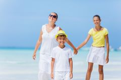 Family of three walking on the beach Royalty Free Stock Image