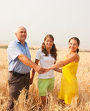 Family of Three in a Meadow Royalty Free Stock Image