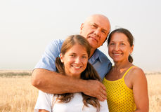 Family of Three in a Meadow stock image