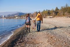 Family of three near the Black Sea in winter sunny Stock Photography