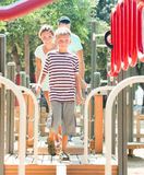 Family of three overcoming the obstacle course Royalty Free Stock Photo