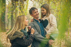 Family of three in park Stock Image