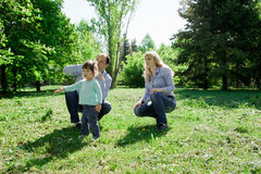 A family of three people are allowed to make soap bubbles. Stock Photos
