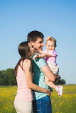 Family of three people having fun outside. Father holding her li royalty free stock images