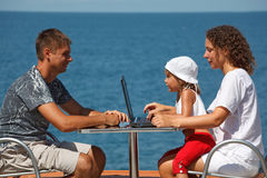 Family of three people resting on sea Royalty Free Stock Photos