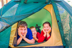 Family of three people resting Royalty Free Stock Image