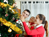 Family of three preparing for Christmas Royalty Free Stock Image