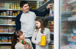 Family of three purchasing food for week Stock Image