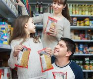 Family of three purchasing food for week Royalty Free Stock Photo