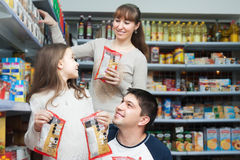 Family of three purchasing food for week Royalty Free Stock Images