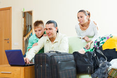 Family of three  reserving tickets for vacation Stock Photography