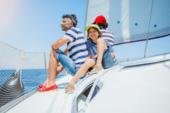 Family of three resting on yacht. Happy family with adorable son resting on a big yacht Royalty Free Stock Photography
