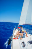 Family of three resting on yacht. Happy family with adorable son resting on a big yacht Royalty Free Stock Images