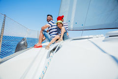 Family of three resting on yacht. Happy family with adorable son resting on a big yacht Royalty Free Stock Image