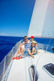 Family of three resting on yacht. Happy family with adorable son resting on a big yacht Stock Images