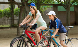 Family of three  riding bikes Royalty Free Stock Photography