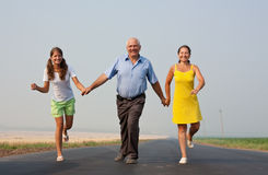 Family of Three on road Stock Image