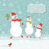 Family of three snowmen. Family of snowmen, greeting Christmas card Royalty Free Stock Images