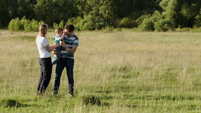 Family of three spending time together outdoor Stock Photography