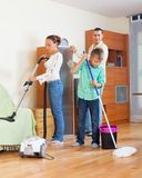 Family of three vacuuming together Stock Photography