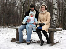 Family of three in winter Royalty Free Stock Photo
