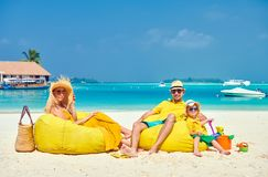 Family with three year old boy on beach royalty free stock photo