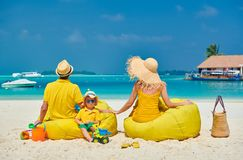 Family with three year old boy on beach stock photos